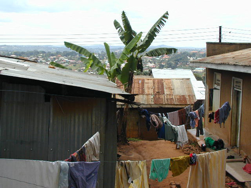 Laundry hanging on lines outside homes