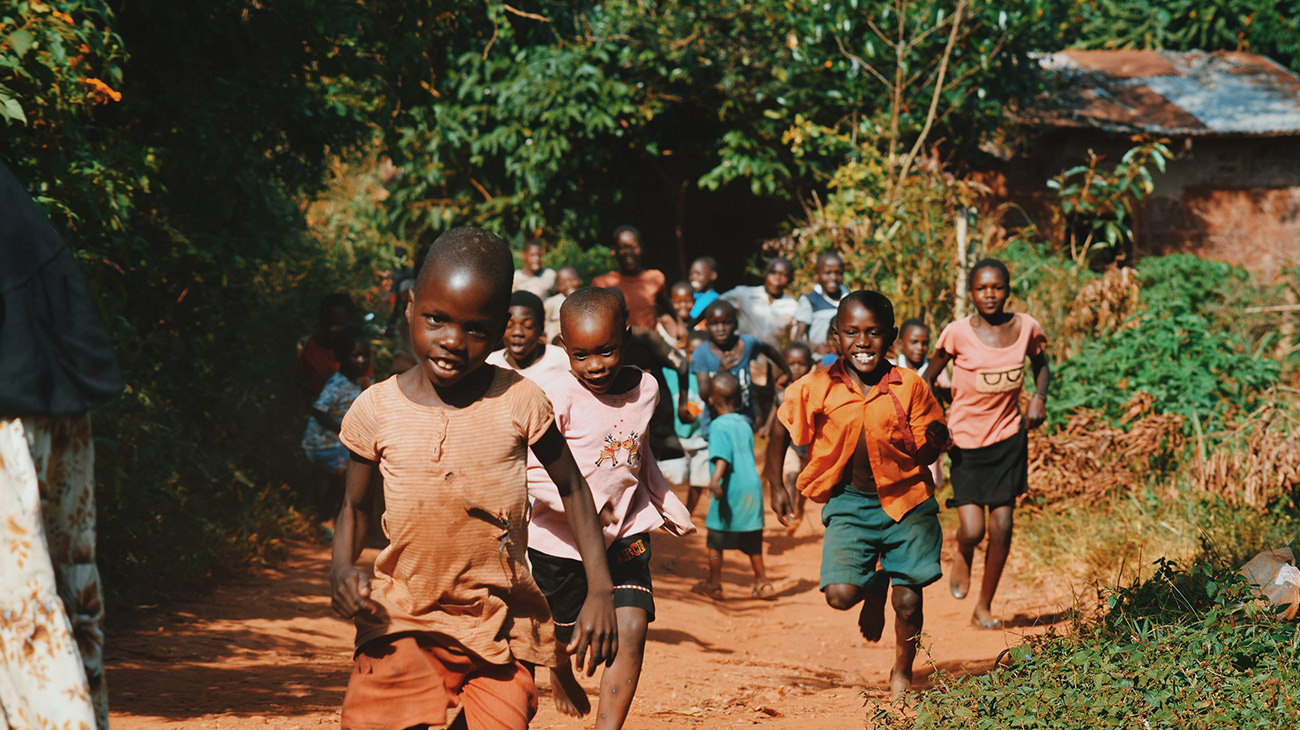 Uganda CHildren Running Down the Road